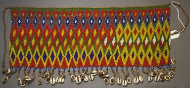 Kirdi. <em>Beaded Apron</em>, early 20th century. Colored glass beads, cotton, shells, 6 5/8 x 17 7/8 in.  (16.8 x 45.4 cm);. Brooklyn Museum, Gift of Mark S. Rapoport, M.D. and Jane C. Hughes, 1999.133.8. Creative Commons-BY (Photo: Brooklyn Museum, 1999.133.8_front_PS10.jpg)