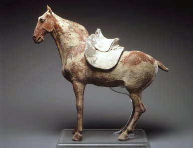 <em>Figure of a Horse with Saddle</em>, late 6th century. Earthenware, traces of pigment, 19 1/2 x 22 x 5 1/2 in. (49.5 x 56.0 x 14.0 cm). Brooklyn Museum, Gift of Peter W. Scheinman, 1999.138a-b. Creative Commons-BY (Photo: Brooklyn Museum, 1999.138a-b_transp4807.jpg)