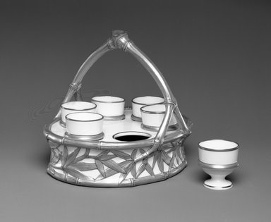 Worcester Royal Porcelain Co. (founded 1751). <em>Egg Cup Stand with 6 Egg Cups</em>, 1879. Porcelain, Stand: 6 1/4 x 7 5/8 x 7 5/8 in. (15.9 x 19.4 x 19.4 cm). Brooklyn Museum, Gift of the Estate of Harold S. Keller, 1999.152.218a-g. Creative Commons-BY (Photo: Brooklyn Museum, 1999.152.218a-g_bw.jpg)