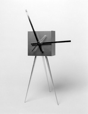 Karim Rashid (Canadian, born Egypt, 1960). <em>Abaxial Clock</em>, 1992. Aluminum and other metals, 9 x 4 1/4 x 4 1/4 in. (22.9 x 10.8 x 10.8 cm). Brooklyn Museum, Gift of Karim Rashid, 1999.28.7. Creative Commons-BY (Photo: Brooklyn Museum, 1999.28.7_bw.jpg)