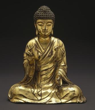 <em>Seated Buddha Shakyamuni</em>, 965 or 1025. Gilt bronze, 8 1/2 x 7 1/4 x 4 3/4 in. (21.6 x 18.4 x 12.1 cm). Brooklyn Museum, Gift of the Asian Art Council in memory of Mahmood T. Diba and Mary Smith Dorward Fund, 1999.42. Creative Commons-BY (Photo: Brooklyn Museum, 1999.42_SL1.jpg)