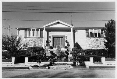 Edward Grazda (American, born 1947). <em>House at Royce Avenue and Avenue V, Bergen Beach, Brooklyn</em>, 1997. Gelatin silver photograph, image: 15 1/2 x 22 3/4 in. (39.4 x 57.8 cm). Brooklyn Museum, Robert A. Levinson Fund, 1999.64.1. © artist or artist's estate (Photo: Brooklyn Museum, 1999.64.1_bw.jpg)