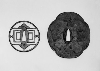 <em>Sword Guard (Tsuba)</em>, 19 th century (possibly). Pierced iron (sukashi); Hammered iron, 4 1/2 x 4 1/8 in.  (11.4 x 10.5 cm). Brooklyn Museum, Gift of Dr. and Mrs. Barry Brumberg, 1999.98.6. Creative Commons-BY (Photo: , 1999.98.5_1999.98.6_view1_bw.jpg)
