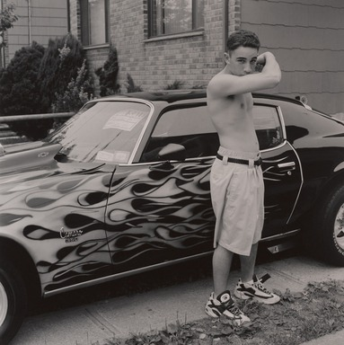 Gerard Vezzuso (American, born 1943). <em>Young Man in Front of Camaro, Staten Island, NY</em>, 1998. Gelatin silver photograph, sheet: 20 x 24 7/8 in.  (50.8 x 63.2 cm). Brooklyn Museum, Gift of the artist, 2000.122.1. © artist or artist's estate (Photo: , 2000.122.1_PS9.jpg)