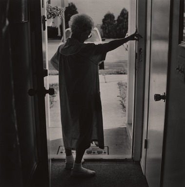 Gerard Vezzuso (American, born 1943). <em>Woman at Door, Bayville, NJ</em>, 2000. Gelatin silver photograph, sheet: 20 7/8 x 24 7/8 in.  (53.0 x 63.2 cm). Brooklyn Museum, Gift of the artist, 2000.122.3. © artist or artist's estate (Photo: , 2000.122.3_PS9.jpg)