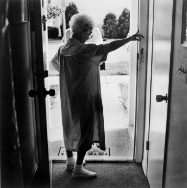 Gerard Vezzuso (American, born 1943). <em>Woman at Door, Bayville, NJ</em>, 2000. Gelatin silver photograph, sheet: 20 7/8 x 24 7/8 in.  (53.0 x 63.2 cm). Brooklyn Museum, Gift of the artist, 2000.122.3. © artist or artist's estate (Photo: Brooklyn Museum, 2000.122.3_bw.jpg)