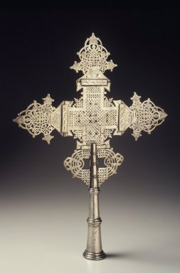 Amhara. <em>Processional Cross (qäqwami mäsqäl)</em>, mid-20th century. Silver-plated metal alloy, 19 x 13 1/2 x 2 in.  (48.3 x 34.3 x 5.1 cm). Brooklyn Museum, Gift of Eric Goode, 2000.123.1. Creative Commons-BY (Photo: Brooklyn Museum, 2000.123.1_transp4138.jpg)