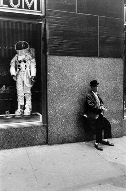 Joel Meyerowitz (American, born 1938). <em>Rockefeller Center (Man and Astronaut Suit)</em>, 1970. Gelatin silver photograph, Sheet: 14 x 11 in. (35.6 x 27.9 cm). Brooklyn Museum, Gift of Julian and Elaine Hyman, 2000.132.10. © artist or artist's estate (Photo: Brooklyn Museum, 2000.132.10_bw.jpg)