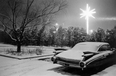 Joel Meyerowitz (American, born 1938). <em>JFK Airport (Caddy and Christmas Star)</em>, 1968. Gelatin silver photograph, Sheet: 11 x 14 in. (27.9 x 35.6 cm). Brooklyn Museum, Gift of Julian and Elaine Hyman, 2000.132.1. © artist or artist's estate (Photo: Brooklyn Museum, 2000.132.1_bw.jpg)