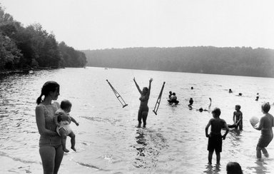 Joel Meyerowitz (American, born 1938). <em>Lake in Catskill Mountains (Woman Throws Crutches)</em>, 1971. Gelatin silver photograph, Sheet: 11 x 14 in. (27.9 x 35.6 cm). Brooklyn Museum, Gift of Julian and Elaine Hyman, 2000.132.2. © artist or artist's estate (Photo: Brooklyn Museum, 2000.132.2_bw.jpg)