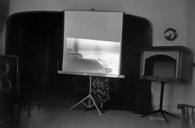 Joel Meyerowitz (American, born 1938). <em>New Jersey Interior  (Airplane on Screen)</em>, 1965. Gelatin silver photograph, Sheet: 11 x 14 in. (27.9 x 35.6 cm). Brooklyn Museum, Gift of Julian and Elaine Hyman, 2000.132.3. © artist or artist's estate (Photo: Brooklyn Museum, 2000.132.3_bw.jpg)