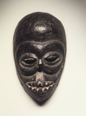 Ibibio. <em>Mask</em>, early 20th century. Wood, 11 x 6 3/4 x 3 1/8 in.  (27.9 x 18.7 x 7.9 cm). Brooklyn Museum, Gift of Blake Robinson, 2000.38.1. Creative Commons-BY (Photo: Brooklyn Museum, 2000.38.1_transp4684.jpg)