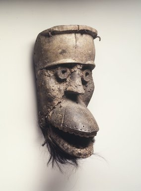 Dan. <em>Mask with Hinged Jaw (Bu Gle)</em>, 19th century. Wood, organic material, monkey skin, iron nails, 10 1/4 x 5 1/8 x 5 1/2 in.  (26.0 x 13.0 x 14.0 cm). Brooklyn Museum, Gift of Blake Robinson, 2000.38.2. Creative Commons-BY (Photo: Brooklyn Museum, 2000.38.2_transpc003.jpg)
