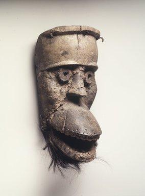 Dan. <em>Mask with Hinged Jaw (Bu Gle)</em>, 19th century. Wood, organic material, monkey skin, iron nails, 10 1/4 x 5 1/8 x 5 1/2 in.  (26.0 x 13.0 x 14.0 cm). Brooklyn Museum, Gift of Blake Robinson, 2000.38.2. Creative Commons-BY (Photo: Brooklyn Museum, 2000.38.2_transpc003.jpg)