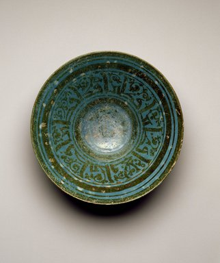 <em>Bowl with Kufic Inscription</em>, mid-12th century. Ceramic, Tell Minis style; fritware, painted in luster over an opaque turquoise glaze, 3 x 9 1/2 in.  (7.6 x 24.1 cm). Brooklyn Museum, Gift of the Asian Art Council, purchased with funds given by the Mark and Anla Cheng Kingdon Foundation and an anonymous donor and Museum Expedition 1913-1914, Museum Collection Fund, by exchange, 2000.40. Creative Commons-BY (Photo: Brooklyn Museum, 2000.40_SL3.jpg)