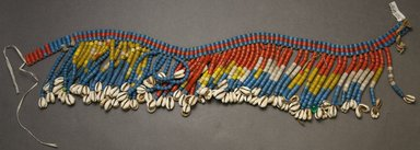Kirdi. <em>Pubic Apron</em>, mid-20th century. Glass beads, cotton, cowrie shells, plastic, 4 1/2 x 26 in.  (11.4 x 66.0 cm). Brooklyn Museum, Gift of Mark S. Rapoport, M.D. and Jane C. Hughes, 2000.69.10. Creative Commons-BY (Photo: Brooklyn Museum, 2000.69.10_front_PS10.jpg)