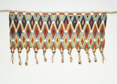 Kirdi. <em>Pubic Apron</em>, mid-20th century. Glass beads, cotton, cowrie shells, 8 1/2 x 15 1/4 in.  (21.6 x 38.7 cm). Brooklyn Museum, Gift of Mark S. Rapoport, M.D. and Jane C. Hughes, 2000.69.11. Creative Commons-BY (Photo: Brooklyn Museum, 2000.69.11_transp6037.jpg)