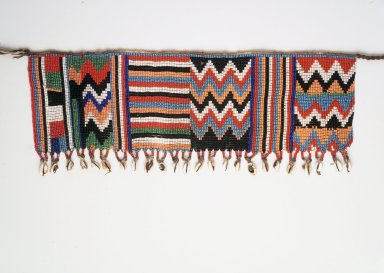 Kirdi. <em>Pubic Apron</em>, mid-20th century. Glass beads, cotton, cowrie shells, 6 1/2 x 17 1/2 in.  (16.5 x 44.5 cm). Brooklyn Museum, Gift of Mark S. Rapoport, M.D. and Jane C. Hughes, 2000.69.13. Creative Commons-BY (Photo: Brooklyn Museum, 2000.69.13_transp6038.jpg)