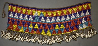 Kirdi. <em>Pubic Apron</em>, mid-20th century. Glass beads, cotton, cowrie shells, 8 1/2 x 20 in.  (21.6 x 50.8 cm). Brooklyn Museum, Gift of Mark S. Rapoport, M.D. and Jane C. Hughes, 2000.69.16. Creative Commons-BY (Photo: Brooklyn Museum, 2000.69.16_front_PS10.jpg)