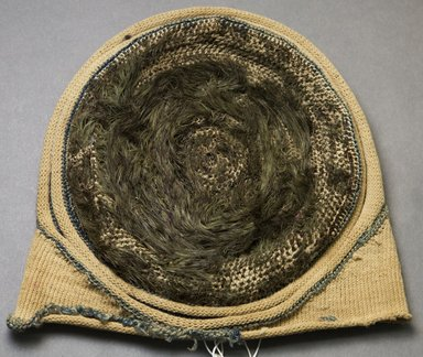 Kirdi. <em>Hat</em>, mid-20th century. Cotton, feathers, 8 1/4 x 9 1/2 in.  (21.0 x 24.1 cm). Brooklyn Museum, Gift of Mark S. Rapoport, M.D. and Jane C. Hughes, 2000.69.2. Creative Commons-BY (Photo: Brooklyn Museum, 2000.69.2_side_PS10.jpg)