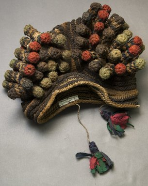 Kirdi. <em>Hat</em>, mid-20th century. Cotton, wool, 9 x 12 1/2 in.  (22.9 x 31.8 cm). Brooklyn Museum, Gift of Mark S. Rapoport, M.D. and Jane C. Hughes, 2000.69.3. Creative Commons-BY (Photo: Brooklyn Museum, 2000.69.3_side_PS10.jpg)