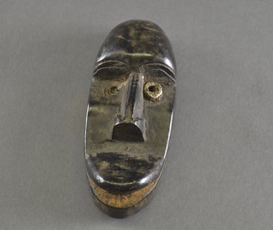 Guerze. <em>Miniature Mask</em>, late 19th-early 20th century. Wood, aluminum, 5 3/4 x 2 5/8 x 1 7/8 in.  (14.6 x 6.7 x 4.8 cm). Brooklyn Museum, Gift of Blake Robinson, 2000.70.2. Creative Commons-BY (Photo: Brooklyn Museum, 2000.70.2_front_PS5.jpg)