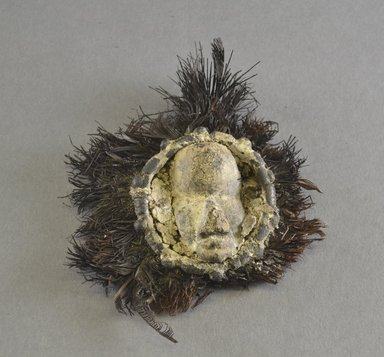 Dan. <em>Miniature Mask</em>, early 20th century. Wood, copper alloy, feathers, fiber, including feathers: 4 1/4 x 4 3/8 x 1 1/4 in.  (10.8 x 11.1 x 3.2 cm). Brooklyn Museum, Gift of Blake Robinson, 2000.70.6. Creative Commons-BY (Photo: Brooklyn Museum, 2000.70.6_front_PS5.jpg)