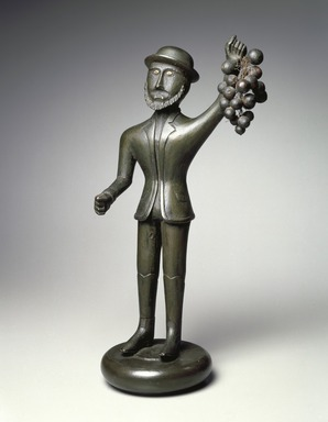 Unknown. <em>Figure of Man with Grapes</em>, ca. 1860. Wood, metal wire, bone, 16 1/2 x 7 1/2 x 5 1/4 in. (41.9 x 19.1 x 13.3 cm). Brooklyn Museum, Gift of The Guennol Collection, 2000.80. Creative Commons-BY (Photo: , 2000.80_SL3.jpg)