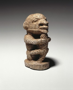 Sapi. <em>Figure of a Man Holding a Crocodile</em>, 15th century or earlier. Stone, 4 x 1 1/2 x 2 1/4 in.  (10.2 x 3.8 x 5.7 cm). Brooklyn Museum, Purchased with funds given by the Noah-Sadie K. Wachtel Foundation, Inc., 2000.93.1. Creative Commons-BY (Photo: Brooklyn Museum, 2000.93.1_SL1_edited.jpg)