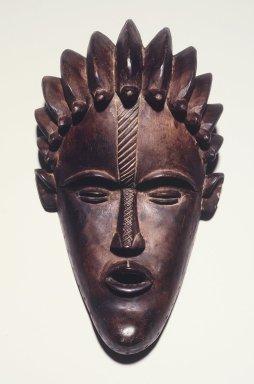 Gbi. <em>Face Mask</em>, early 20th century. Wood, 10 3/4 x 6 3/4 x 4 1/4 in.  (27.3 x 17.1 x 10.8 cm). Brooklyn Museum, Frank L. Babbott Fund, 2000.93.2. Creative Commons-BY (Photo: Brooklyn Museum, 2000.93.2_transp4692.jpg)