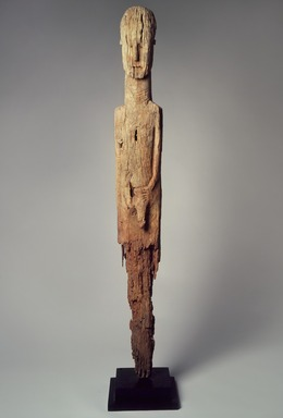 Konso artist. <em>Memorial stela (waakaa or waga)</em>, 19th century. Wood, metal, 52 1/2 x 6 1/2 x 3 1/4 in.  (133.4 x 16.5 x 8.3 cm). Brooklyn Museum, Gift of Serge and Jodie Becker-Patterson, 2000.94.4. Creative Commons-BY (Photo: Brooklyn Museum, 2000.94.4_edited.jpg)
