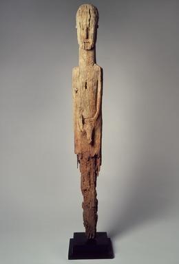 Konso artist. <em>Memorial stela (waakaa or waga)</em>, 19th century. Wood, metal, 52 1/2 x 6 1/2 x 3 1/4 in.  (133.4 x 16.5 x 8.3 cm). Brooklyn Museum, Gift of Serge and Jodie Becker-Patterson, 2000.94.4. Creative Commons-BY (Photo: Brooklyn Museum, 2000.94.4_edited.jpg)