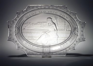 <em>Platter (Cleopatra)</em>, late 19th century. Glass, 1 3/8 x 13 1/4 x 8 5/8 in. (3.5 x 33.7 x 21.9 cm). Brooklyn Museum, Gift of Richard Fazzini and Mary McKercher, 2001.53. Creative Commons-BY (Photo: Brooklyn Museum, 2001.53_transp5208.jpg)