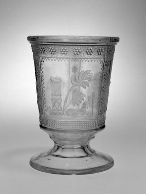 <em>Spooner or Spoon Holder</em>, late 19th century. Pressed colorless glass, height: 5 1/8 in. (13.0 cm); diameter: 3 3/4 in.  (9.5 cm). Brooklyn Museum, Gift of Kevin L. Stayton, 2001.54. Creative Commons-BY (Photo: Brooklyn Museum, 2001.54_bw.jpg)