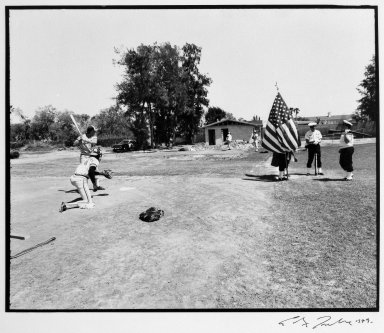 Alex Traube (American, born 1946). <em>Pitcher Warming up, Color Guard,  Dunedin, Fla.</em>, 1979. Gelatin silver photograph, image: 9 1/8 x 11 in.  (23.2 x 27.9 cm). Brooklyn Museum, Gift of the artist, 2001.80. © artist or artist's estate (Photo: Brooklyn Museum, 2001.80_bw.jpg)