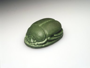 Grueby Faience Co. (1897-1909). <em>Scarab Paperweight</em>, ca. 1904. Glazed earthenware, 1 3/4 x 2 3/4 x 4 in.  (4.4 x 7.0 x 10.2 cm). Brooklyn Museum, H. Randolph Lever Fund, 2001.8. Creative Commons-BY (Photo: Brooklyn Museum, 2001.8_transp4964.jpg)