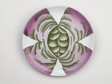 Judy Chicago (American, born 1939). <em>Fertile Goddess Place Setting</em>, 1974-1979. Runner:Cotton/linen base fabric, woven interface support material (horsehair, wool, and linen), cotton twill tape, silk, synthetic gold cord, flax warp, wool, hair weft, shells, bone needles, starfish, ceramic fetish figures, beads, coiled wool yarn medallions, wool cording, thread Plate: Porcelain with overglaze enamel (China paint), rainbow luster, Runner:53 3/8 x 31 3/8 in. (135.6 x 79.7 cm). Brooklyn Museum, Gift of The Elizabeth A. Sackler Foundation, 2002.10-PS-2. © artist or artist's estate (Photo: Brooklyn Museum, 2002.10-PS-2_plate_PS9.jpg)
