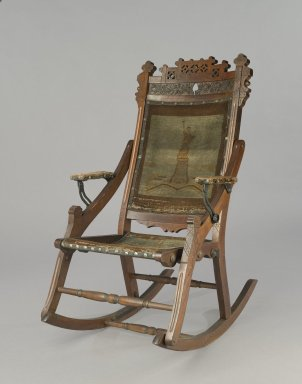 Attributed to Edward W. Vaill (1861-1891). <em>Rocking Chair</em>, ca. 1880. Wood, original woven upholstery, and metal, 39 3/4 x 23 7/8 x 30 1/2 in. (101 x 60.6 x 77.5 cm). Brooklyn Museum, Gift of Dr. Alvin E. Friedman-Kien, 2002.107.3. Creative Commons-BY (Photo: Brooklyn Museum, 2002.107.3_PS6.jpg)