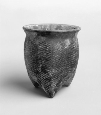 <em>Tripod Vessel (Li)</em>, 7000-1600 B.C.E. Grey earthenware with cord-marked surface decoration, 6 x 5 1/2 in. (15.2 x 14 cm). Brooklyn Museum, Gift of Dr. Alvin E. Friedman-Kien, 2002.119.3. Creative Commons-BY (Photo: Brooklyn Museum, 2002.119.3_bw.jpg)