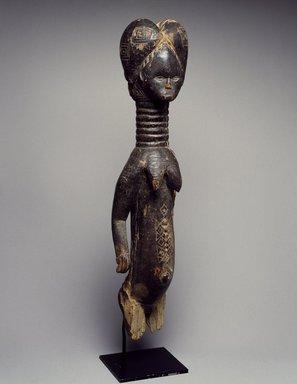 Sherbro. <em>Fragment of a Female Figure</em>, 19th century. Wood, 17 5/16 x 3 13/16 x 3 15/16 in. (44 x 9.7 x 10 cm). Brooklyn Museum, Gift of Blake Robinson, 2002.31.3. Creative Commons-BY (Photo: Brooklyn Museum, 2002.31.3_SL3.jpg)