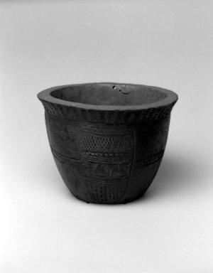 Grebo. <em>Bowl</em>, 19th or 20th century. Wood, metal tacks, metal wire, 7 1/4 x 10 x 10 in.  (18.4 x 25.4 x 25.4 cm). Brooklyn Museum, Gift of Blake Robinson, 2002.31.5. Creative Commons-BY (Photo: Brooklyn Museum, 2002.31.5_bw.jpg)