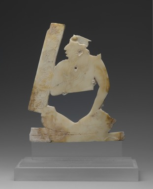 Maya. <em>Seated Figure</em>, ca. C.E. 550-850. Shell, 3 1/2 x 3in. (8.9 x 7.6cm). Brooklyn Museum, Gift of The Guennol Collection, 2002.33. Creative Commons-BY (Photo: Brooklyn Museum, 2002.33a-b_front_PS2.jpg)