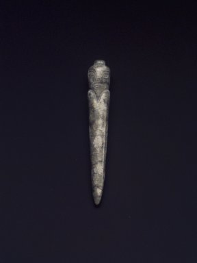 <em>Conical Burial Plug in Stylized Human Form</em>, 20th century. Nephrite, 2 x 3/8 in. (5.1 x 1 cm). Brooklyn Museum, Gift of Mr. and Mrs. Raymond Hargreaves, 2002.36.5. Creative Commons-BY (Photo: Brooklyn Museum, 2002.36.5_transp5688.jpg)
