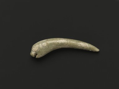 <em>Burial Orifice Plug in Stylized Leaping Form</em>, 20th century. Mottled green nephrite, 1 7/8 x 3/8 in. (4.8 x 1 cm). Brooklyn Museum, Gift of Mr. and Mrs. Raymond Hargreaves, 2002.36.6. Creative Commons-BY (Photo: Brooklyn Museum, 2002.36.6_side1_PS2.jpg)