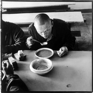 John Ranard (American, 1952 - 2008). <em>Omsk Prison Colony, Omsk, Russia 2001, Prisoner with Bowl of Soup</em>, 2001. Gelatin silver photograph, Sheet: 13 15/16 x 11 in. (35.4 x 27.9 cm). Brooklyn Museum, Gift of the artist, 2002.57.1. © artist or artist's estate (Photo: Brooklyn Museum, 2002.57.1_bw.jpg)