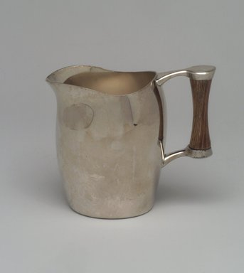 Niagra Falls Silver Co., a Division of Oneida Silversmiths (1877 to present). <em>Creamer, from Three Piece Coffee Service, Heirloom Line</em>, ca. 1955. Silverplate, wood, 4 1/4 x 5 x 2 7/8 in. (10.8 x 12.7 x 7.3 cm). Brooklyn Museum, Gift of Jewel Stern, 2003.11.3. Creative Commons-BY (Photo: Brooklyn Museum, 2003.11.3.jpg)