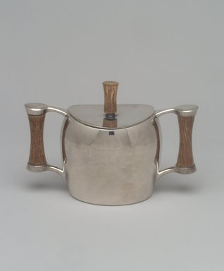 Niagra Falls Silver Co., a Division of Oneida Silversmiths (1877 to present). <em>Sugar Bowl and Lid, from Three Piece Coffee Service, Heirloom Line</em>, ca. 1955. Silverplate, wood, 4 1/4 x 6 1/4 x 3 1/8 in. (10.8 x 15.9 x 7.9 cm). Brooklyn Museum, Gift of Jewel Stern, 2003.11.4a-b. Creative Commons-BY (Photo: Brooklyn Museum, 2003.11.4a-b.jpg)