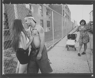Vincent Cianni (American, born 1952). <em>Anthony Hitting On Giselle, Vivien Waiting, Lorimer Street, Williamsburg, Brooklyn, The Southside</em>, 1996. Gelatin silver photograph, Sheet: 11 x 14 in. (27.9 x 35.6 cm). Brooklyn Museum, Gift of Mary Cianni, 2003.18.1. © artist or artist's estate (Photo: Brooklyn Museum, 2003.18.1.jpg)