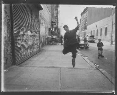 Vincent Cianni (American, born 1952). <em>Jump, South 1st Street, Williamsburg, Brooklyn</em>, 1995. Gelatin silver photograph, Sheet: 11 x 14 in. (27.9 x 35.6 cm). Brooklyn Museum, Gift of Mary Cianni, 2003.18.2. © artist or artist's estate (Photo: Brooklyn Museum, 2003.18.2.jpg)