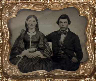 American. <em>[Untitled] (Portrait of a Seated Man and Woman)</em>, ca. 1857-1864. Ambrotype in a thermoplastic case, Case: 3 3/4 x 3 1/4 x 3/4 in. (9.5 x 8.3 x 1.9 cm). Brooklyn Museum, Gift of Rosemarie Haag Bletter and Martin Filler, 2003.39 (Photo: Brooklyn Museum, 2003.39.jpg)